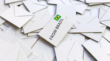 levelezés : Envelope with From Brazil text on pile of other envelopes. International mail related conceptual 3D animation