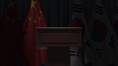 podyum : Flags of China and South Korea and speaker podium tribune. Political event or negotiations related conceptual 3D animation Stok Video