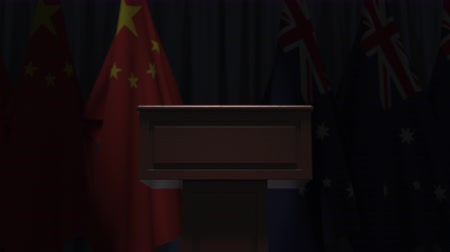 political speech : Flags of China and Australia and speaker podium tribune. Political event or negotiations related conceptual 3D animation Stock Footage