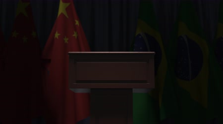 political speech : Flags of China and Brazil and speaker podium tribune. Political event or negotiations related conceptual 3D animation