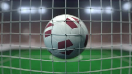 Латвия : Football with flags of Latvia hits goal net. Slow motion 3D animation
