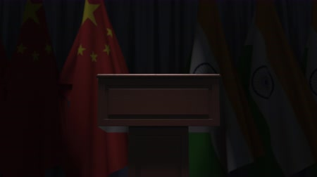 podyum : Flags of China and India and speaker podium tribune. Political event or negotiations related conceptual 3D animation Stok Video