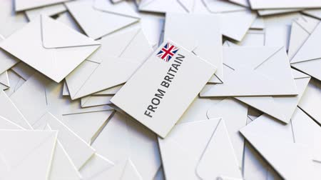 adresa : Letter with From Britain text on pile of other Letters. International mail related conceptual 3D animation