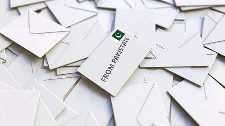 correspondência : Letter with From Pakistan stamp among other Letters. International mail related conceptual 3D animation