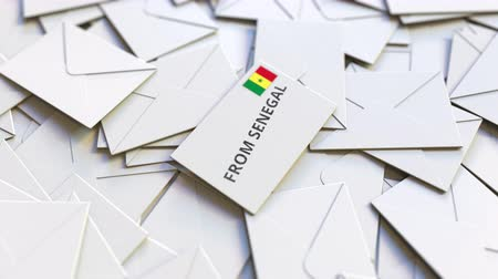 news letter : Envelope with From Senegal stamp among other envelopes. International mail related conceptual 3D animation