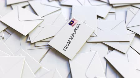 переписка : Letter with From Malaysia stamp among other Letters. International mail related conceptual 3D animation