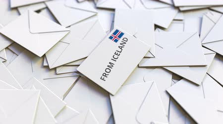news letter : Envelope with From Iceland text on pile of other envelopes. International mail related conceptual 3D animation