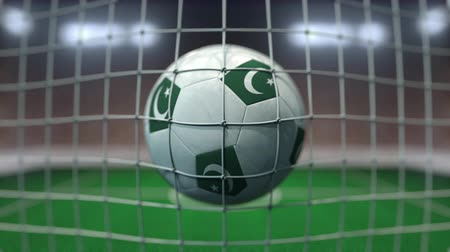 Пакистан : Football with flags of Pakistan in net against blurred stadium. Conceptual 3D animation