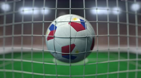 philippine : Football with flags of Philippines in net against blurred stadium. Conceptual 3D animation