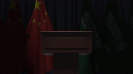 podyum : Flags of China and Saudi Arabia and speaker podium tribune. Political event or negotiations related conceptual 3D animation Stok Video