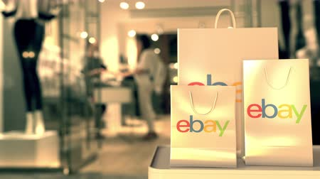 ebay : Shopping bags with eBay logo. Editorial online shopping versus retail related 3D animation