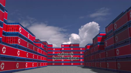 сделанный : Containers with MADE IN NORTH KOREA text and national flags. Import or export related 3D animation Стоковые видеозаписи
