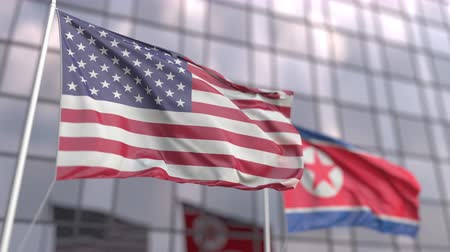 ассоциация : Waving flags of the USA and North Korea in front of a modern skyscraper facade