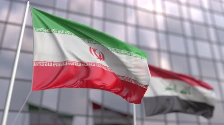штаб квартира : Waving flags of Iran and Iraq in front of a modern skyscraper facade