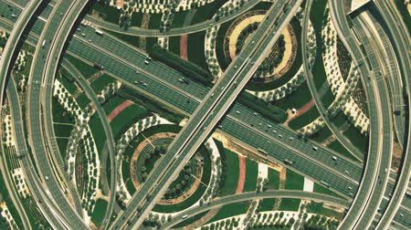 hajózik : Aerial top down hyperlapse of a major highway interchange traffic resembling percent sign Stock mozgókép