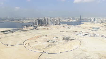 kusy : DUBAI, UNITED ARAB EMIRATES - DECEMBER 30, 2019. Aerial view of foundations for the Dubai Creek Tower, the tallest skyscraper in the world