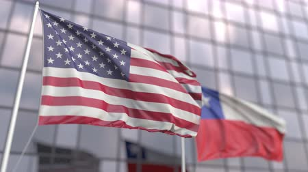 штаб квартира : Waving flags of the United States and Chile in front of a modern skyscraper facade Стоковые видеозаписи