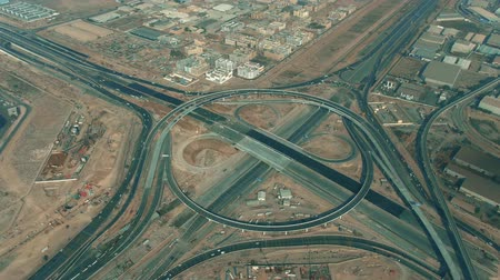 rampa : Aerial view of a big highway interchange construction in Dubai, UAE Stok Video