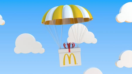 mcdonalds : Carton with MCDONALDS logo falls with a parachute. Editorial loopable 3D animation Stock Footage