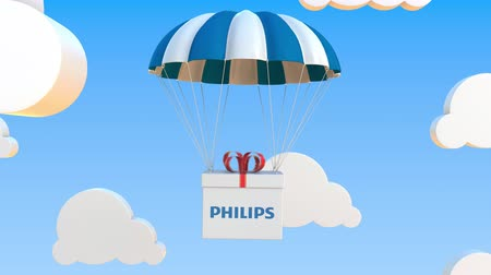 padák : Box with PHILIPS logo falls with a parachute. Editorial loopable 3D animation