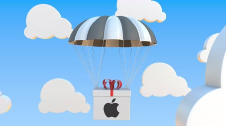 inc : Box with APPLE INC logo falls with a parachute. Editorial loopable 3D animation
