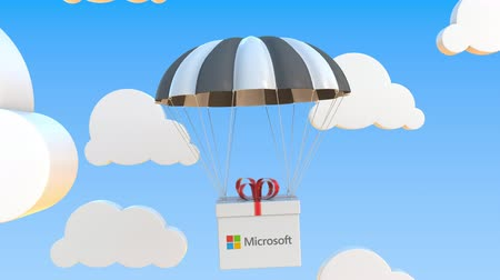 logo : MICROSOFT logo on moving box moves under parachute. Editorial loopable 3D animation