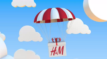 sziám : H&M logo on moving Box moves under parachute. Editorial loopable 3D animation Stock mozgókép