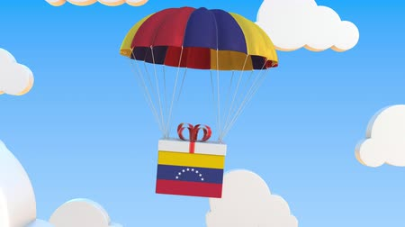padák : Box with national flag of Venezuela falls with a parachute. Loopable conceptual 3D animation