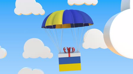 padák : Carton with flag of Ukraine falls with a parachute. Loopable conceptual 3D animation
