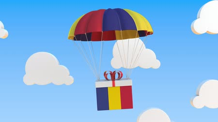 romeno : Box with national flag of Romania falls with a parachute. Loopable conceptual 3D animation