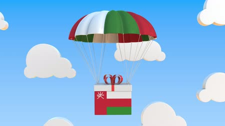 padák : Box with national flag of Oman falls with a parachute. Loopable conceptual 3D animation