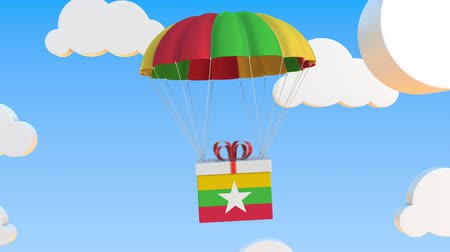 padák : Carton with flag of Myanmar falls with a parachute. Loopable conceptual 3D animation