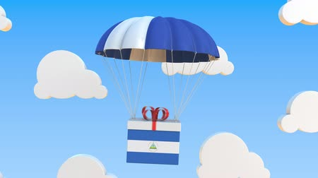 nicaraguan : Box with national flag of Nicaragua falls with a parachute. Loopable conceptual 3D animation