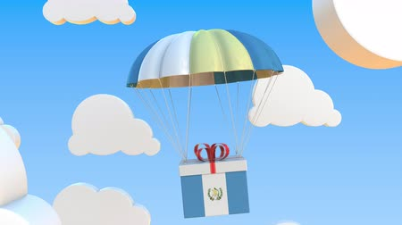 padák : Box with national flag of Guatemala falls with a parachute. Loopable conceptual 3D animation