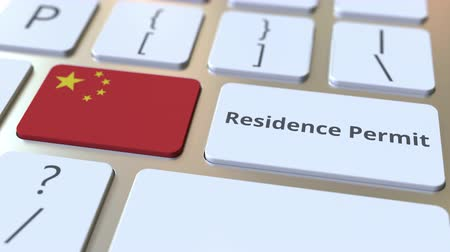 göçmen : Residence Permit text and flag of China on the buttons on the computer keyboard. Immigration related conceptual 3D animation