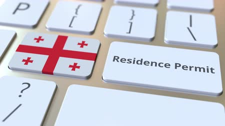 göçmen : Residence Permit text and flag of Georgia on the buttons on the computer keyboard. Immigration related conceptual 3D animation