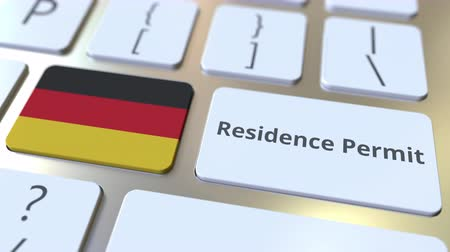 reside : Residence Permit text and flag of Gemany on the buttons on the computer keyboard. Immigration related conceptual 3D animation Stock Footage