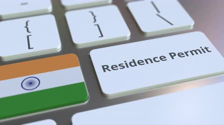 expat : Residence Permit text and flag of India on the buttons on the computer keyboard. Immigration related conceptual 3D animation