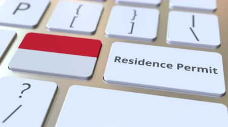 göçmen : Residence Permit text and flag of Indonesia on the buttons on the computer keyboard. Immigration related conceptual 3D animation