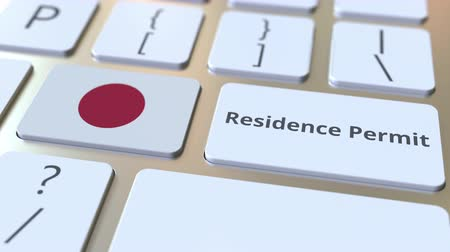 reside : Residence Permit text and flag of Japan on the buttons on the computer keyboard. Immigration related conceptual 3D animation