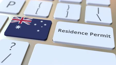 expat : Residence Permit text and flag of Australia on the buttons on the computer keyboard. Immigration related conceptual 3D animation