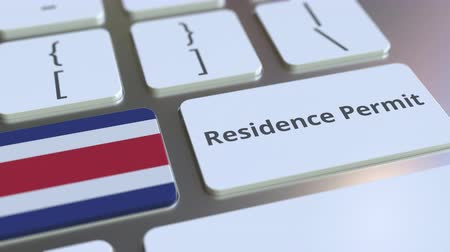 reside : Residence Permit text and flag of Costa Rica on the buttons on the computer keyboard. Immigration related conceptual 3D animation Stock Footage