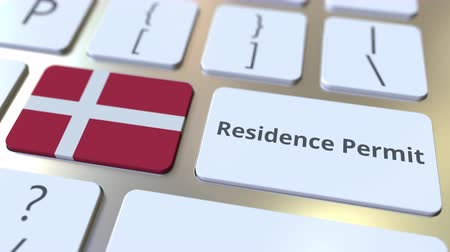 göçmen : Residence Permit text and flag of Denmark on the buttons on the computer keyboard. Immigration related conceptual 3D animation Stok Video