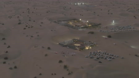show off : Aerial shot of recreational desert camps in the evening, United Arab Emirates UAE Stock Footage