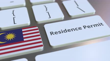 expat : Residence Permit text and flag of Malaysia on the buttons on the computer keyboard. Immigration related conceptual 3D animation Stock Footage