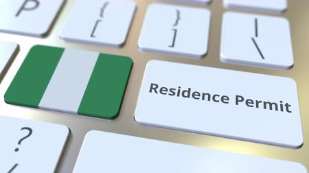 reside : Residence Permit text and flag of Nigeria on the buttons on the computer keyboard. Immigration related conceptual 3D animation