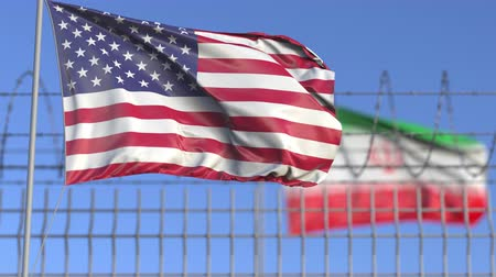 elválasztott : Waving flags of the USA and Iran separated by barbed wire fence. Conflict related loopable conceptual 3D animation