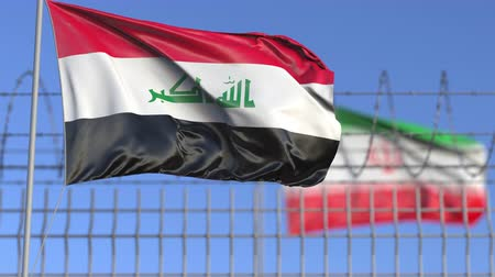 confronto : Waving flags of Iraq and Iran separated by barbed wire fence. Conflict related loopable conceptual 3D animation