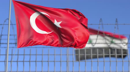 elválasztott : Waving flags of Turkey and Syria separated by barbed wire fence. Conflict related loopable conceptual 3D animation