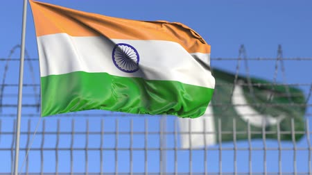 farpado : Waving flags of India and Pakistan separated by barbed wire fence. Conflict related loopable conceptual 3D animation